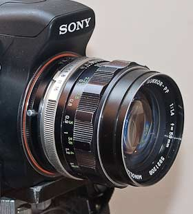 Minolta Rokkor 58mm f/1.4 lens mounted on the Sony Alpha A350. You can see the adapter inserted between the silver aperture ring and the orange marking on the Alpha lens mount.