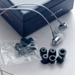 In addition to the BassBuds and the Bass bag, each kit comes bundled with numerous rubber ear pieces in white and black.