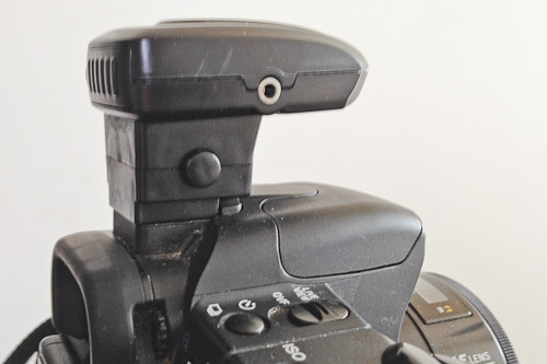Cowboy Studio flash trigger installed on a Sony Alpha dSLR