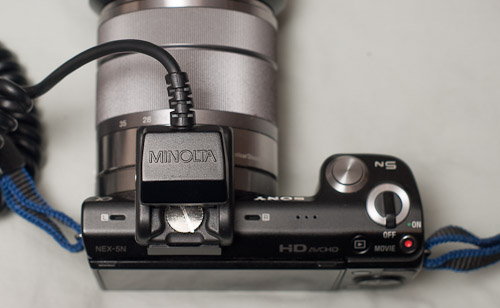 Top view of the flash adapter with a sync cord attached